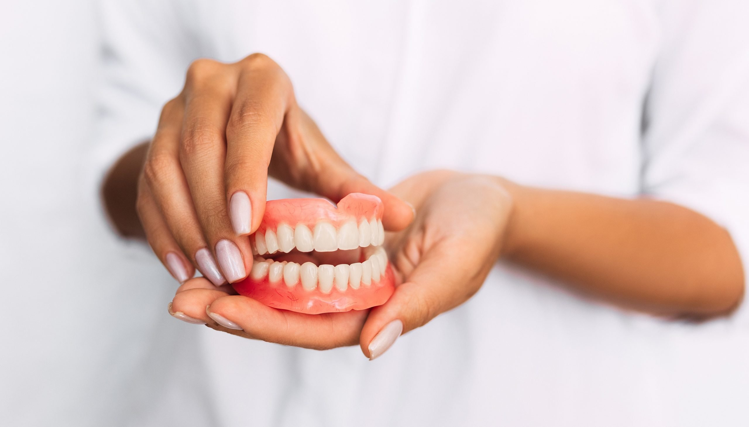 fitting dentures to improve your smile